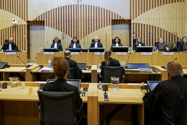 FILE - In this file photo dated Monday, June 8, 2020, Presiding judge Hendrik Steenhuis, rear fourth from left, opens the court session as the trial resumed for three Russians and a Ukrainian charged with crimes including murder for their alleged roles in the shooting down of Malaysia Airlines Flight MH17 over eastern Ukraine nearly six years ago, at the high security court building at Schiphol Airport, near Amsterdam.  Judges in the trial on Friday July 3, 2020, have granted requests for further investigations submitted by lawyers representing one of the Russian suspects. (AP Photo/Robin van Lonkhuijsen, FILE)