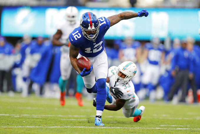 New York Giants wide receiver Cody Latimer (12) runs past Miami Dolphins cornerback Jomal Wiltz (33) in the second half of an NFL football game, Sunday, Dec. 15, 2019, in East Rutherford, N.J. (AP Photo/Adam Hunger)