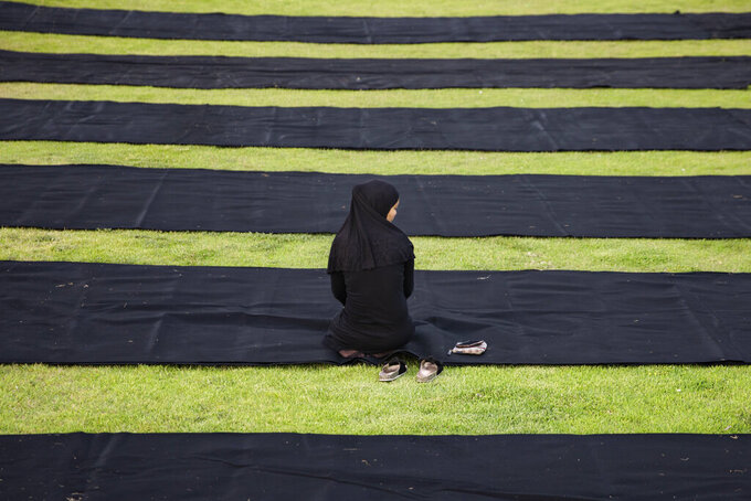 A Muslim worshipper offers Eid al-Adha prayer in the mixed Arab Jewish city of Jaffa, near Tel Aviv, Israel, Tuesday, July 20, 2021. The major Muslim holiday, at the end of the hajj pilgrimage to Mecca, is observed around the world by believers and commemorates prophet Abraham's pledge to sacrifice his son as an act of obedience to God. (AP Photo/Oded Balilty)