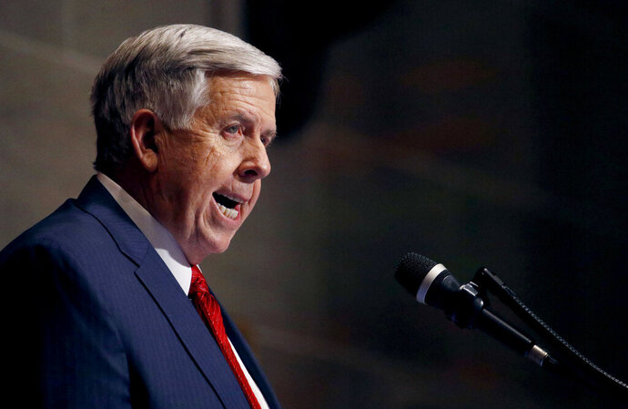 FILE - In this Jan. 16, 2019, file photo, Missouri Gov. Mike Parson delivers his State of the State address in Jefferson City, Mo. Parson on Wednesday, May 15, called on state senators to take action on a bill to ban abortions at eight weeks of pregnancy, the latest GOP-dominated state emboldened by the possibility that a more conservative Supreme Court could overturn its landmark ruling legalizing the procedure. (AP Photo/Charlie Riedel, File)