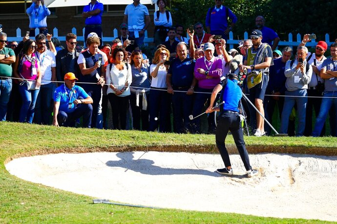 Britain's Danny Willett gets out of a sand trap at the 18th hole during the second day of the Golf Italian Open 2019, in Rome, Friday, Oct. 11, 2019. (Giorgio Maiozzi/ANSA via AP)