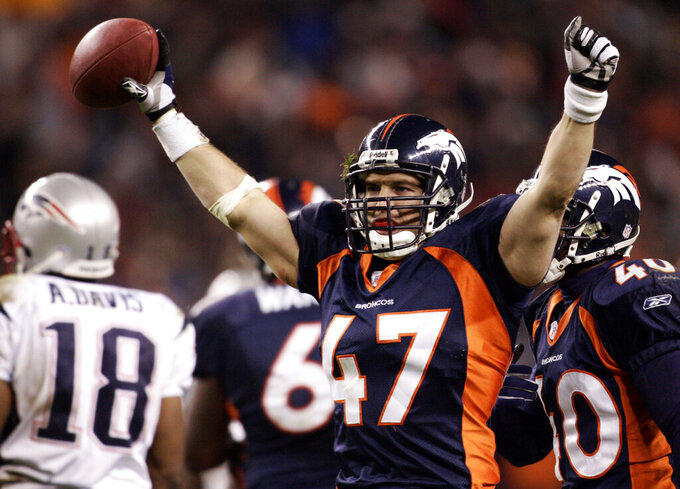 FILE - In this Jan. 14, 2006, file photo, Denver Broncos safety John Lynch celebrates an interception against the New England Patriots during the fourth quarter of an AFC divisional playoff game at Invesco Field at Mile High in Denver. Lynch was selected as a finalist for the Pro Football Hall of Fame's class of 2021 on Tuesday, Jan. 5, 2021. (AP Photo/Jack Dempsey, File)