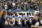 Philadelphia Eagles' Malcolm Jenkins, center left, raises his fist during the national anthem before the team's preseason NFL football game against the Pittsburgh Steelers, Thursday, Aug. 9, 2018, in Philadelphia. (AP Photo/Matt Rourke)