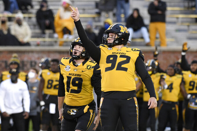 Missouri place kicker Harrison Mevis (92) celebrates alongside teammate Grant McKinniss (19) after kicking a 20-yard field goal during the second half of an NCAA college football game against Kentucky Saturday, Oct. 24, 2020, in Columbia, Mo. (AP Photo/L.G. Patterson)