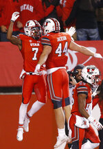 Utah wide receiver Demari Simpkins (7) celebrates with Jake Jackson (44) after catching a pass for a touchdown against Arizona during the first half of an NCAA college football game Friday, Oct. 12, 2018, in Salt Lake City. (AP Photo/Rick Bowmer)