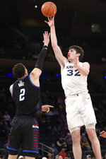 Xavier forward Zach Freemantle (32) shoots over DePaul forward Jaylen Butz (2) during the first half of an NCAA college basketball game in the first round of the Big East men's tournament Wednesday, March 11, 2020, in New York. (AP Photo/Kathy Willens)