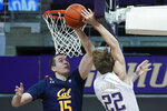 California forward Grant Anticevich (15) blocks a shot by Washington guard Cole Bajema (22) during the first half of an NCAA college basketball game Saturday, Feb. 20, 2021, in Seattle. (AP Photo/Ted S. Warren)