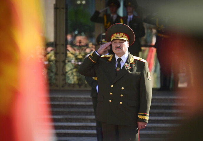 Belarusian President Alexander Lukashenko salutes during his inauguration ceremony at the Palace of the Independence in Minsk, Belarus, Wednesday, Sept. 23, 2020. Lukashenko of Belarus has assumed his sixth term of office in an inauguration ceremony that wasn't announced in advance. State news agency BelTA reported that Wednesday's ceremony is taking place in the capital of Minsk, with several hundred top government official present. (Andrei Stasevich/Pool Photo via AP)