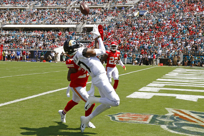 Jacksonville Jaguars wide receiver D.J. Chark, right, catches a pass in front of Kansas City Chiefs cornerback Kendall Fuller for a 35-yard touchdown during the first half of an NFL football game, Sunday, Sept. 8, 2019, in Jacksonville, Fla. (AP Photo/Stephen B. Morton)