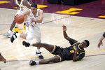 Valparaiso's Zion Morgan (2) loses control of the ball to Loyola Chicago's Lucas Williamson during the second half of an NCAA college basketball game Wednesday, Feb. 17, 2021, in Chicago. Loyola Chicago won 54-52. (AP Photo/Charles Rex Arbogast)