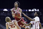 Stanford guard Bryce Wills, center, shoots between Oklahoma forward Brady Manek (35) and guard Jamal Bieniemy (24) during the second half of an NCAA college basketball game Monday, Nov. 25, 2019, in Kansas City, Mo. Stanford won 73-54. (AP Photo/Charlie Riedel)