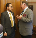 Kansas House Majority Leader Dan Hawkins, right, R-Wichita, confers with Rep. Blake Carpenter, R-Derby, before an unsuccessful attempt to revive an anti-abortion bill vetoed by Democratic Gov. Laura Kelly, Thursday, May 2, 2019, at the Statehouse in Topeka, Kansas. Carpenter led the effort to save the bill, which would require abortion providers to tell patients that a medication abortion can be reversed once it has been started. (AP Photo/John Hanna)