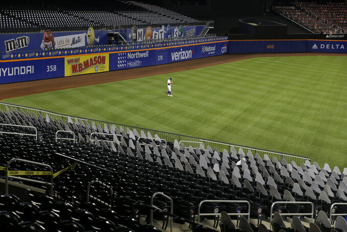 New York Mets left fielder J.D. Davis plays during the sixth inning of the baseball game against the Boston Red Sox at Citi Field, Thursday, July 30, 2020, in New York. (AP Photo/Seth Wenig)
