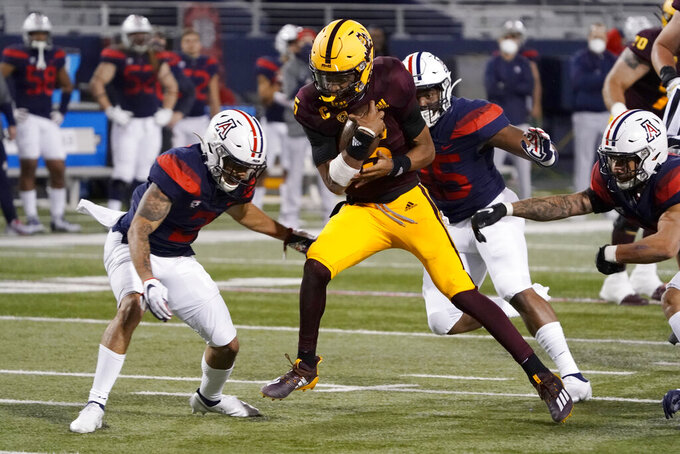 Arizona State quarterback Jayden Daniels (5) scores a touchdown against Arizona in the first half of an NCAA college football game, Friday, Dec. 11, 2020, in Tucson, Ariz. (AP Photo/Rick Scuteri)
