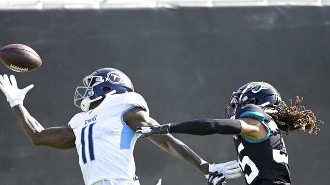 Tennessee Titans wide receiver A.J. Brown (11) makes a reception for a 37-yard touchdown in front of Jacksonville Jaguars cornerback Sidney Jones, right, during the first half of an NFL football game, Sunday, Dec. 13, 2020, in Jacksonville, Fla. (AP Photo/Phelan M. Ebenhack)