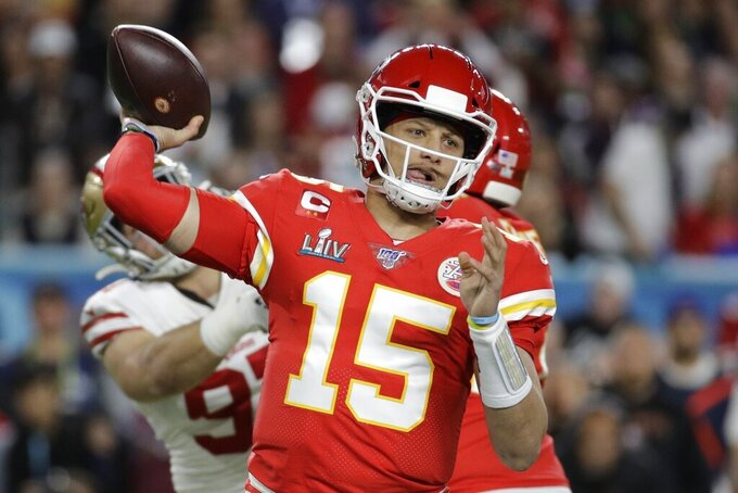 FILE - In this Feb. 2, 2020, file photo, Kansas City Chiefs quarterback Patrick Mahomes (15) passes against the San Francisco 49ers during the first half of the NFL Super Bowl 54 football game in Miami Gardens, Fla. The Chiefs made sure they will have Super Bowl MVP Mahomes around as long as possible. Mahomes agreed to a 10-year extension worth $503 million, according to his agency, Steinberg Sports. The deal is worth $477 million in guarantee mechanisms and includes a no-trade clause and opt-out clauses if guarantee mechanisms are not met. It is the richest contract in professional sports history, surpassing Mike Trout's $426.5 million deal with the Los Angeles Angels. (AP Photo/Patrick Semansky, File)