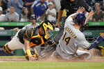 Pittsburgh Pirates catcher Michael Perez, left, looks to tag Milwaukee Brewers' Jace Peterson, who scores on a throwing error in the sixth inning of the second baseball game of the doubleheader Saturday, Aug. 14, 2021, in Pittsburgh.(AP Photo/Keith Srakocic)
