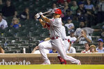 Cincinnati Reds' Shogo Akiyama watches his RBI double off Chicago Cubs relief pitcher Cory Abbott during the ninth inning of a baseball game Wednesday, July 28, 2021, in Chicago. The Reds won 8-2. (AP Photo/Charles Rex Arbogast)