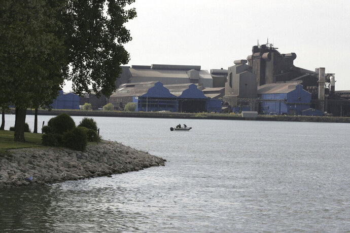 FILE- This June 2, 2009 file photo shows  the U.S. Steel plant on Zug Island.  Great Lakes Works, the century-plus old blast furnaces that made the steel that built America, is mostly idle now, but the mill — despite social media rumors — has a little life left in it yet. In 2020, U.S. Steel said it would indefinitely idle major operations at the factories, sending notices to 1,545 employees. Now, there are about 500 workers left and just a small slice of what it was at its peak. In the late 1940s, more than 16,000 men reportedly worked there. (Patrica Beck/Detroit Free Press via AP)