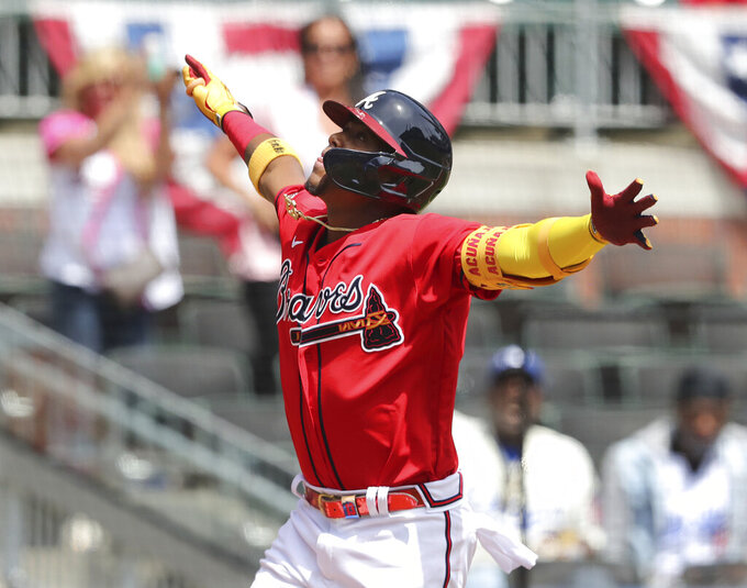 Atlanta Braves' Ronald Acuna reacts on his way home after hitting a two-run home run against the Miami Marlins during the fifth inning of a baseball game Thursday, April 15, 2021, in Atlanta. (Curtis Compton/Atlanta Journal-Constitution via AP)