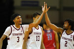 Stanford forward Ziaire Williams (3) celebrates with guard Bryce Wills (2) during the second half of an NCAA college basketball game against Arizona in Santa Cruz, Calif., Saturday, Dec. 19, 2020. Also pictured is Oscar da Silva (13). (AP Photo/Jeff Chiu)