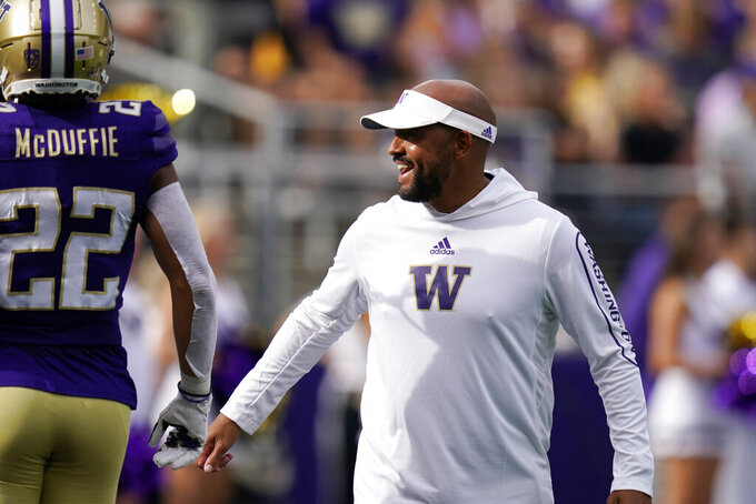 Washington head coach Jimmy Lake, right, greets Trent McDuffie before an NCAA college football game against Montana Saturday, Sept. 4, 2021, in Seattle. (AP Photo/Elaine Thompson)