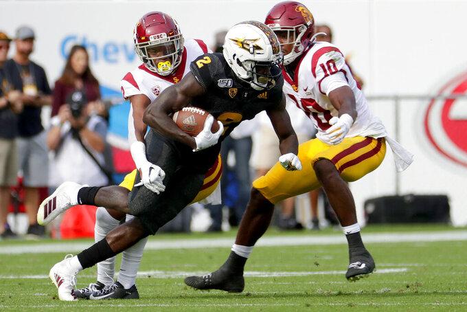 Arizona State wide receiver Brandon Aiyuk (2) makes a catch as Southern California linebacker John Houston Jr. (10) defends during the first half of an NCAA college football game, Saturday, Nov. 9, 2019, in Tempe, Ariz. (AP Photo/Matt York)