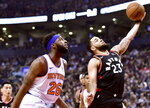 New York Knicks centre Mitchell Robinson (26) looks on as Toronto Raptors guard Fred VanVleet (23) drives to the net during first half NBA basketball action in Toronto, Monday, March 18, 2019. (Frank Gunn/The Canadian Press via AP)