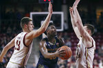 Notre Dame guard TJ Gibbs, center, threads between Boston College forwards Luka Kraljevic, left, and Nik Popovic, right, during the first half of an NCAA men's college basketball game in Boston, Wednesday, Feb. 26, 2020. (AP Photo/Charles Krupa)