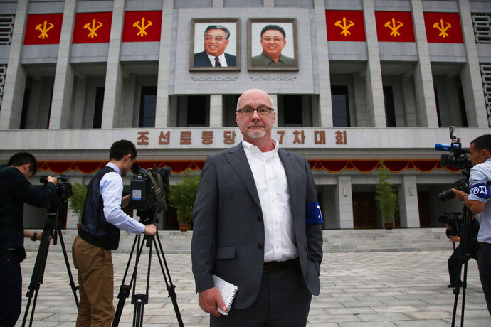 This Monday, May 9, 2016 photo shows The Associated Press' North Korea Bureau Chief Eric Talmadge in front of the April 25 House of Culture where the party congress is held in the North Korean capital of Pyongyang. Talmadge, who tenaciously chronicled life and politics in North Korea, one of the world's least-understood nations, died after suffering a heart attack in Japan. He was 57.  (AP Photo/Wong Maye-E)