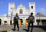 FILE - In this April 22, 2019, file photo, Sri Lankan Navy soldiers stand guard in front of the St. Anthony's Shrine in Colombo, Sri Lanka. On Easter Sunday, April 21, bombs shattered the celebratory services at two Catholic churches and a Protestant church in Sri Lanka. (AP Photo/Eranga Jayawardena)