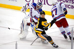 New York Rangers goaltender Igor Shesterkin, left, clears the puck in front of Pittsburgh Penguins' Teddy Blueger (53) during the period of an NHL hockey game in Pittsburgh, Friday, Jan. 22, 2021. (AP Photo/Gene J. Puskar)
