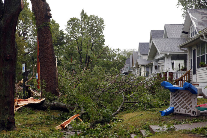 Downed trees and other debris cover front yards in Cedar Rapids, Iowa, after a powerful storm moved through Iowa on Monday, Aug. 10, 2020. (Liz Martin/The Gazette via AP)