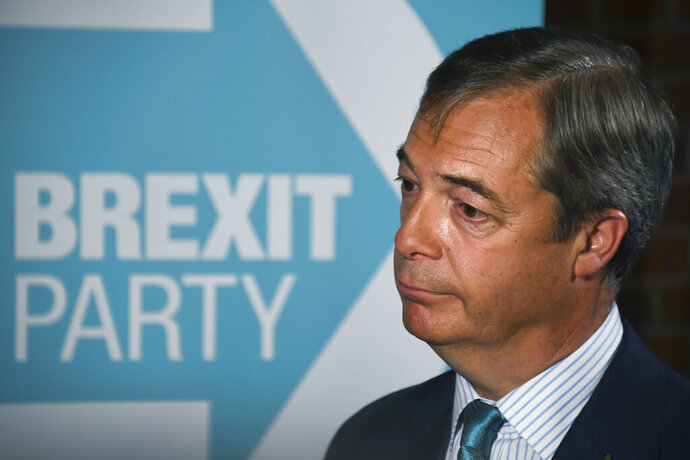 Brexit Party leader Nigel Farage launches his party's manifesto ahead of the upcoming General Election, in London, Friday, Nov. 1, 2019.  Farage kicked off the Brexit Party campaign Friday for Britain's December general election.(AP Photo/Alberto Pezzali)