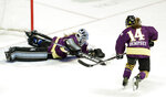 "FILE- In this Feb. 10, 2019, file photo, Team Stecklein goalie Nicole Hensley, left, dives on the puck as Jillian Dempsey, right, watches for the rebound in the first period of the NWHL All-Star Hockey Game in Nashville, Tenn. The women's hockey league thinks it can make it work with the same kind of COVID-19 testing the NBA used in its Disney World bubble. Players, coaches and staff will essentially be limited to hotel and Herb Brooks Arena, the site of the 1980 ""Miracle on Ice"" that serves as a historic setting for a unique season.  (AP Photo/Mark Humphrey, File)"