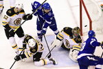 Tampa Bay Lightning left wing Ondrej Palat (18) scores the winning goal on Boston Bruins goaltender Jaroslav Halak (41) during overtime of an NHL Stanley Cup Eastern Conference playoff hockey game in Toronto,  Ontario, Tuesday, Aug. 25, 2020. (Frank Gunn/The Canadian Press via AP)