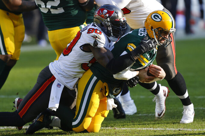 Tampa Bay Buccaneers' Shaquil Barrett (58) sacks Green Bay Packers quarterback Aaron Rodgers during the first half of the NFC championship NFL football game in Green Bay, Wis., Sunday, Jan. 24, 2021. (AP Photo/Jeffrey Phelps)