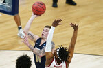 Oral Roberts guard Carlos Jurgens (11) shoots over Arkansas guard JD Notae during the first half of a Sweet 16 game in the NCAA men's college basketball tournament at Bankers Life Fieldhouse, Saturday, March 27, 2021, in Indianapolis. (AP Photo/Darron Cummings)
