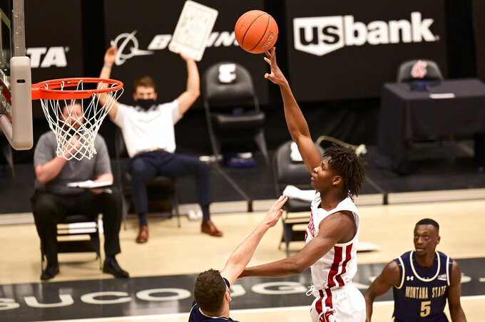 Washington State center Efe Abogidi (0) attempts to shoot as Montana State forward Borja Fernandez (23) defends and guard Amin Adamu (5) looks on in the first half of an NCAA college basketball game, Friday, Dec. 18, 2020, in Pullman, Wash. (Pete Caster/Lewiston Tribune via AP)