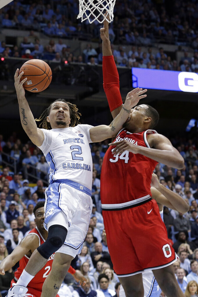 North Carolina guard Cole Anthony (2) drives to the basket against Ohio State forward Kaleb Wesson (34) during the first half of an NCAA college basketball game in Chapel Hill, N.C., Wednesday, Dec. 4, 2019. (AP Photo/Gerry Broome)