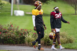 Washington quarterback Dwayne Haskins Jr., (7), left, and safety Landon Collins (20) arrive for practice at the team's NFL football training facility, Wednesday, Aug. 19, 2020, in Ashburn, Va. (AP Photo/Alex Brandon)