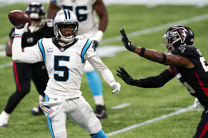 Atlanta Falcons defensive end Dante Fowler Jr. (56) pressures Carolina Panthers quarterback Teddy Bridgewater (5) during the first half of an NFL football game, Sunday, Oct. 11, 2020, in Atlanta. (AP Photo/John Bazemore)