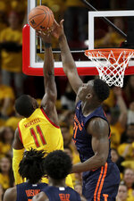 Illinois center Kofi Cockburn (21) blocks a shot from Maryland guard Darryl Morsell (11) during the first half of an NCAA college basketball game, Saturday, Dec. 7, 2019, in College Park, Md. (AP Photo/Julio Cortez)
