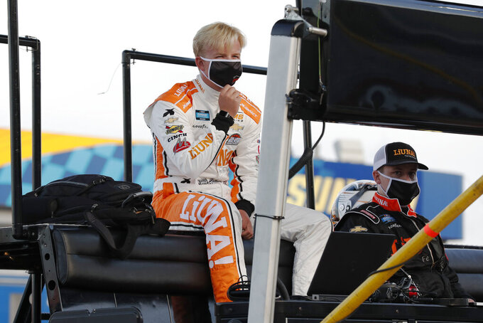 Driver Tyler Ankrum waits for the start of a NASCAR Truck Series auto race at Charlotte Motor Speedway Tuesday, May 26, 2020 in Concord, N.C. (AP Photo/Gerry Broome)