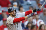 Boston Red Sox's J.D. Martinez watches his RBI-double against the Los Angeles Angels during the first inning of a baseball game in Anaheim, Calif., Saturday, Aug. 31, 2019. (AP Photo/Chris Carlson)
