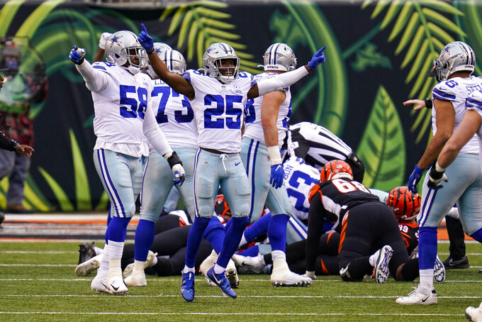 Dallas Cowboys free safety Xavier Woods (25) celebrates a fumble recover y the defense against the Cincinnati Bengals in the first half of an NFL football game in Cincinnati, Sunday, Dec. 13, 2020. (AP Photo/Bryan Woolston)