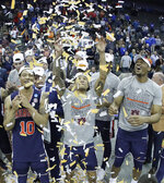Auburn players celebrate after the Midwest Regional final game against Kentucky in the NCAA men's College basketball tournament Sunday, March 31, 2019, in Kansas City, Mo. Auburn won 77-71 in overtime. (AP Photo/Charlie Riedel)