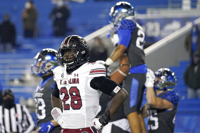 South Carolina defensive back Darius Rush (28) looks toward his bench as Kentucky players celebrate a touchdown during the second half of an NCAA college football game, Saturday, Dec. 5, 2020, in Lexington, Ky. (AP Photo/Bryan Woolston)