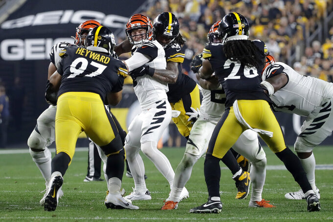 Pittsburgh Steelers outside linebacker Bud Dupree (48) sacks Cincinnati Bengals quarterback Andy Dalton (14) and strips the ball during the first half of an NFL football game in Pittsburgh, Monday, Sept. 30, 2019. The Steelers recovered the fumble. (AP Photo/Don Wright)