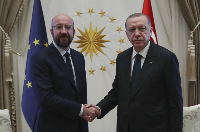 Turkish President Recep Tayyip Erdogan, right, and European Council President Charles Michel shake hands before a meeting, in Ankara, Turkey, Wednesday, March 4, 2020.  The two are expected to discuss the situation in Syria and migrants.(Presidential Press Service via AP, Pool)